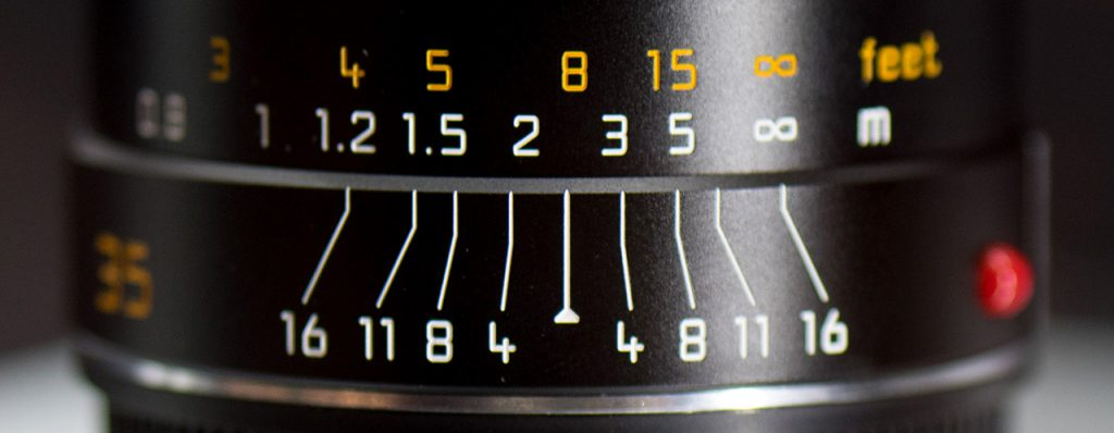 Distance scale (top) and depth of field scale (bottom) on a Leica Summarit-M 35 mm f/2.4 ASPH manual focus lens.